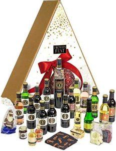 """Wein-Adventskalender mit 24 Türchen, liebevoll gefüllt mit ausgesuchten, erlesenen Köstlichkeiten aus der Felsengartenkellerei Besigheim. In diesem einzigartigen Präsent finden sich ausgewählte Weine in der 0,25l-Flasche, eine 0,75l-Flasche der Premiumserie """"Fels"""", sowie kleine Köstlichkeiten und viele Überraschungen rund um Wein."""